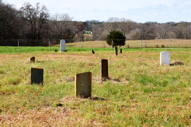 foreground - grave of Ananias Thomas, background -gave of Merriman Little, distant landscape - location of bridge and likely site of Meeting House ford.
