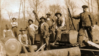 Milling crew: John Adam Burris to the far right, Martin Dry to the far left, Lee Dry seated on a log near John Adam Burris